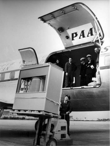 5 megabyte IBM hard disk being loaded into a plain (1965)